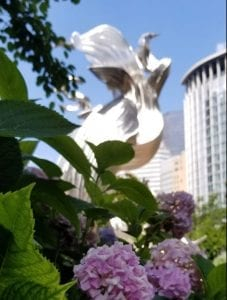 Statue at Charlotte's Romare Bearden Park with Blooming Spring Flowers