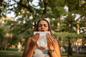 woman sneezing from pollen allergy